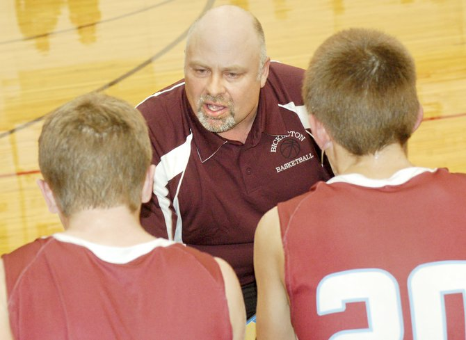 Bickleton Coach Jerry Roberts encourages his players during last night's 57-43 loss to Granger.