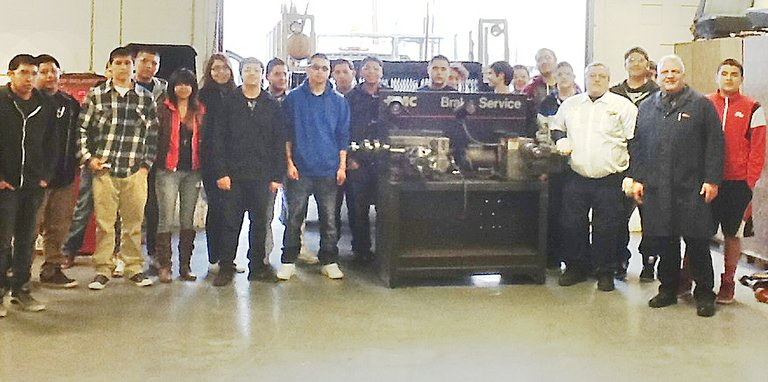 Students taking auto shop classes at Sunnyside High School now have access to a brake lathe, courtesy of Sunnyside's Les Schwab Tire Center. The lathe was Tuesday delivered to the auto shop, giving students the ability to resurface brakes, rotors and drums. Delivering the lathe to Nick Paulakis (front right) and his students was Les Schwab alignment technician Larry Pangle (front second from right).