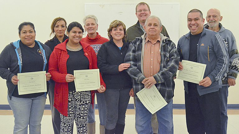 Volunteers receiving certificates of appreciation from Sunnyside Transformation Yakima Valley last night included (front L-R) Ana Bautista, Lilia Huerta, Veronica Gutierrez, Ruben Carrera and Jose Mora; (back L-R) Hortencia Hernandez, Mary Werkhoven, Eric Placzek and Ken Hill.