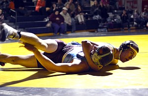 MAKING A STATE-MENT, Hood River Val-ley High School varsity wrestling had solid per-formances this week in duals against Lincoln, Wilson, The Dalles and Stevenson. Pictured is Andrew DeHart winning by fall in the team's 60-15 defeat of the Bulldogs.