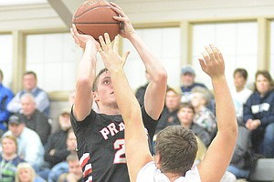 Prairie's Lucas Arnzen shoots over a Grangeville defender.
