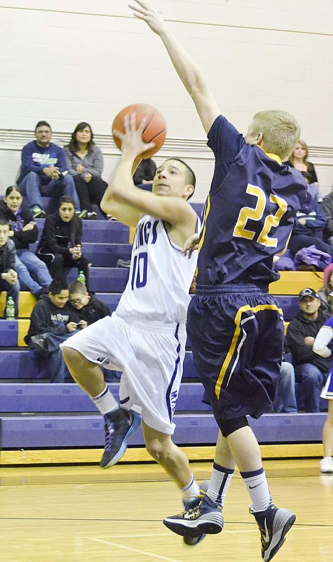 Mabton's Roy Zavala drives for a lay-up against Naches Valley's James Stillwaugh last Saturday during the Vikes' 69-54 loss. A night earlier, last Friday, Mabton was defeated at Zillah by a score of 68-50. The top Viking scorer both nights was Luis Ruiz, with 11 points against the Rangers on Saturday and 9 points against the Leopards. Mabton's overall record fell to 2-8 with the pair of losses. The Vikes return to action tomorrow, Tuesday, with a home game against Highland.