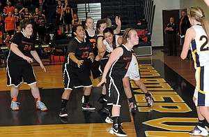 Marlie Bloomster prepares to inbound to Monique Lara, her lone remaining teammate, in the fourth quarter of a victory by the HRV girls JV basketball team over Sprague.
