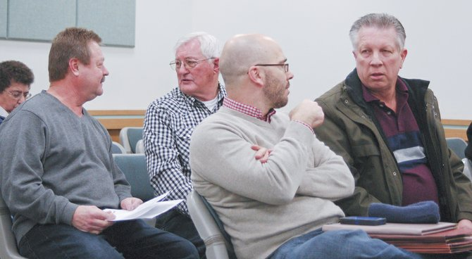 Representatives from the Port of Sunnyside were present at Monday night's Sunnyside City Council meeting to conduct the annual business of the Sunnyside Industrial Development Corporation. Waiting for their turn at the podium are (L-R) Commissioner Jim Grubenhoff, Commissioner Arnold Martin, Executive Director Jay Hester and Commissioner Jeff Matson. The corporation is a joint venture between the city and port.