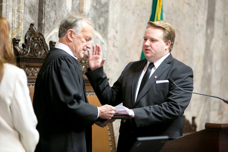 Republican Sen. Brian Dansel of Republic, right, was sworn into office Monday by Justice James Johnson in Olympia.