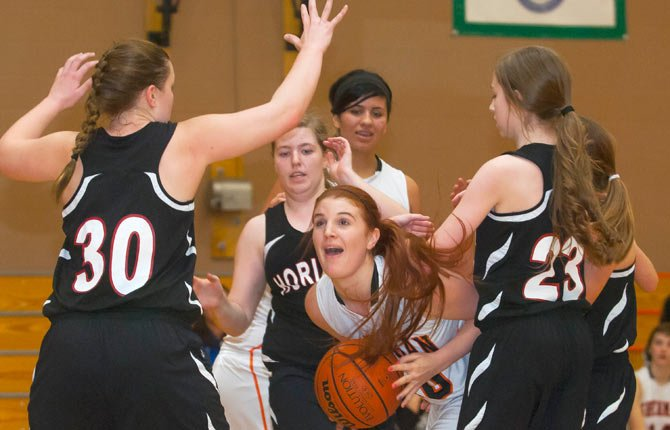 Sherman senior Katie Poirier struggles to break through a pack of Horizon defenders during Tuesday's game in Moro. Poirier scored seven points and the Huskies snapped a four-game losing streak with a 47-11 victory.