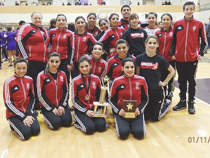 The Grizzly Dance Team holds its trophies earned last Saturday, following a competition at Hanford High School. The SHS team qualified for Districts with runner-up honors in the hip-hop category and earned the showmanship award.