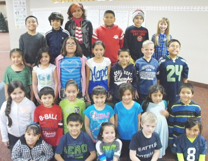 Washington Elementary is recognizing students for their outstanding reading efforts in the Accelerated Reader program each month. The readers of the month for December in the first, second and third grades are (front row L-R) Marilyn Macias, Esai Armendariz, Emma Beltran, Braden Rice and Dulce Contreras; (second row L-R)  Jaila Rosalez, Joshua Sagal, Corina Chavez, Emily Islas, Taylor Lewis, Irene Ramos and Rudy Mendoza; (third row L-R)  Nazaret Quiroz, Lency Gonzalez, Milenka Gonzalez, Mireya Gutierrez, Fabian Meraz, Cole Morrow and Angel Ortega; (back row L-R)  Mario Alvarez, David Ramirez, Estrella Carrillo, Javier Allejo, Alex Ramirez and Alex Zieske.