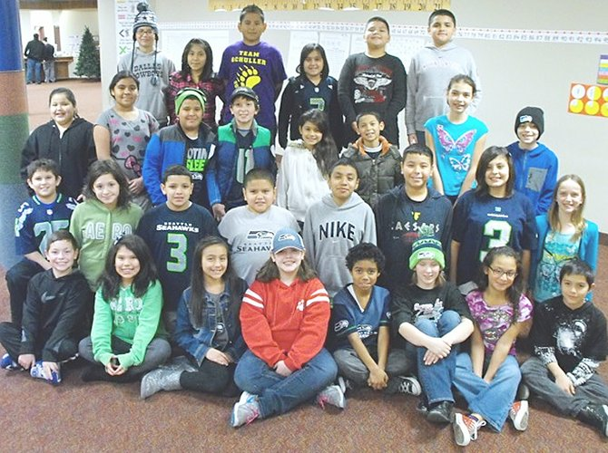 Washington Elementary December readers of the month in fourth and fifth grades are (front row L-R)  Benjamin Anderson, Alexandra Bazan, Nevaeh Palomarez, Mya Martinez, Marcus Mayfield, Natalee Morrow, Ruby Reyes and Zackary Dominguez; (second row L-R)  Zakkery Garcia, Lanae Gutierrez, Isaiah Isquierdo, Cristian Lopez, Luis Lopez, James Chumley, Leandra Cisneros and Riley Harris; (third row L-R)  Monique Pena, Jesell Perez, Diego Pinon, Coby Little, Niomi Meza, Gonzalo Palafox, Amerie Stroh and Chris Cardenas; (back row L-R)  Nathalia Lopez, Nicole Miranda, Alex Mojica, Alexandria Ponce, Kobe Sanchez and Juan Valle.