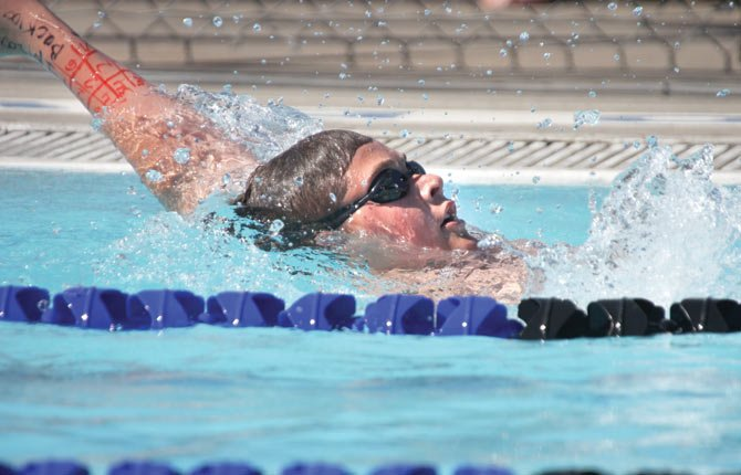THE DALLES WAHTONKA swimmer Max McClennan cuts through the water in his backstroke try at the Mount Hood Swim Meet. This weekend in Hood River for the Eagle Indian Invitational, the Tribe put up some good times against 11 other teams as preparation for the district meet in February.