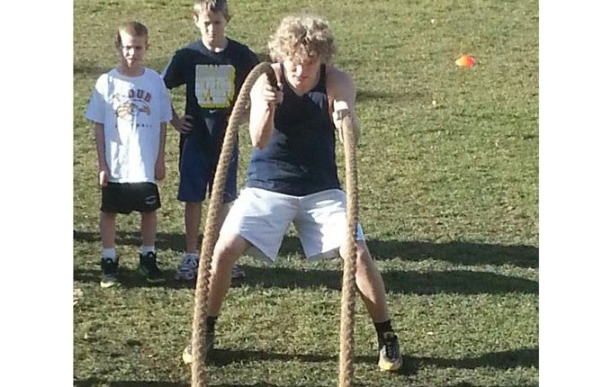 TDW senior football player Blake Diede works out a Training for Success session this past summer while middle school athletes Kade Wilson (left) and Ben Nelson observe. With the departure of TFS coach Ron Diede, the program has an opening availabe for dedicated parents who want to keep the foundation built for future athletes as they strive to win state titles.