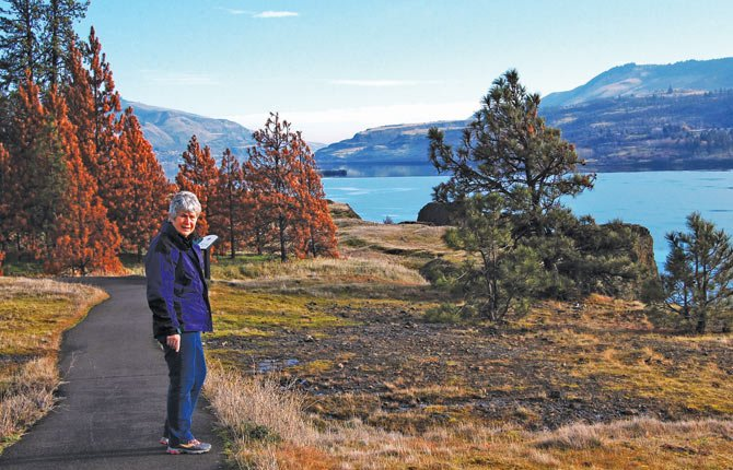 JANET TSCHANZ stands on a paved, universal  access trail leading to stellar Columbia Gorge vistas, just one choice in the 30-mile trail system stretching between Catherine Creek and Coyote Wall. Trails to meet all levels of fitness and skill are among the choices.