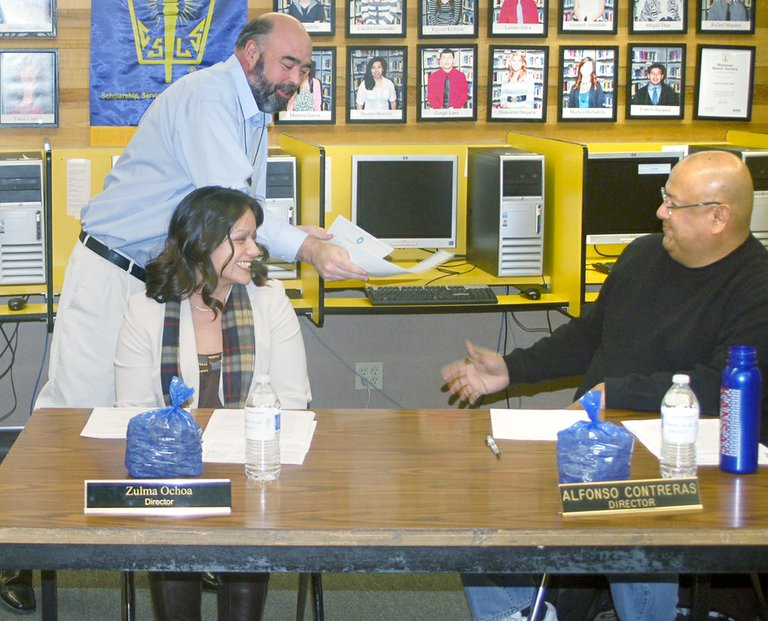Grandview School District Superintendent Kevin Chase thanks the District Board of Directors (L-R) Zuluma Ochoa and Alfonso Contreras for their hours of service to the education of Grandview children during a brief ceremony held during last week's regular meeting of the board. Assistant Superintendent Brad Shreeve read the Governor's proclamation declaring January as School Board Directors Appreciation Month as part of the evening's presentation.