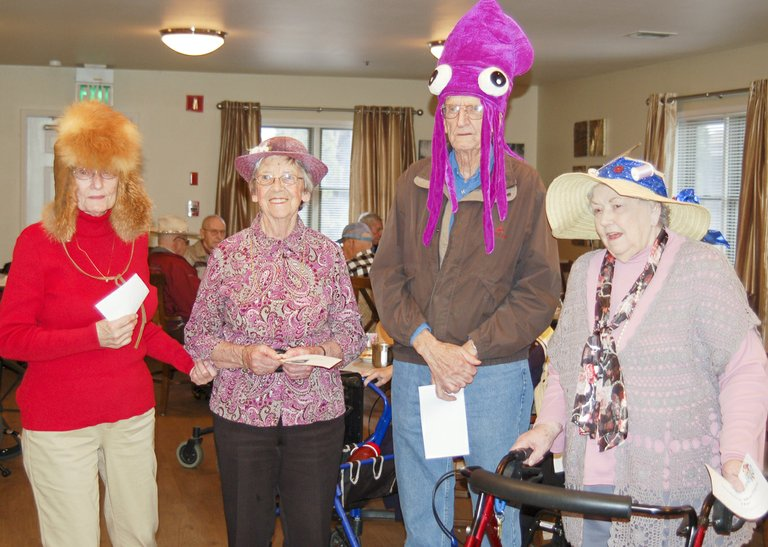 Several residents were recognized on crazy hat day at Sunnyside's Sun Terrace Assisted Living & Retirement last Friday for their efforts at stylish headwear. From left, Frances Potts won an award for silliest hat, Rena Van Oostrum won for prettiest hat, Bob Kelly's squid hat earned him the award for ugliest hat and Lillyan Carr's sewing supply hat garnered her honors for most original hat.