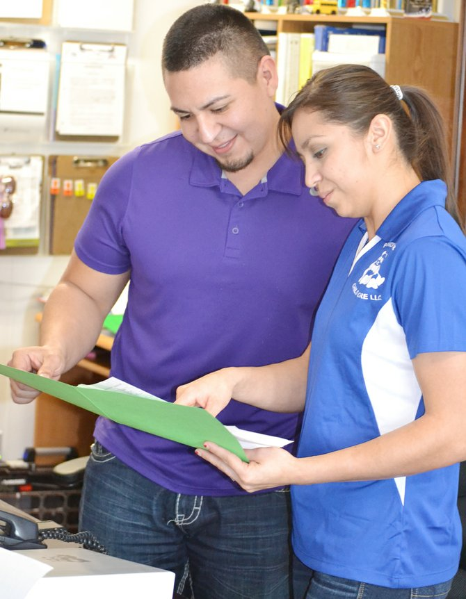 Catalina Bazaldua and husband Jorge review information during their work day together at Panda Bear Childcare.
