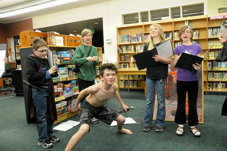 Grangeville Centennial Library Readers Theater members were busy practicing last Tuesday evening, Jan. 14, for their upcoming Jan. 25 performance. 