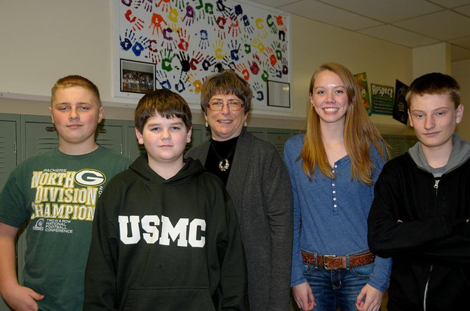 "Pictured (L-R) are Grangeville Elementary Middle School eight grade students Justin Biebow, Wyatt Perry, teacher Betty Nafziger, Kally Arnzen and Tyler Stephens. Perry recently won a Daughters of the American Revolution regional essay contest and Biewbow, Arnsen and Stephens were awarded ""exceptional essay"" certificates."