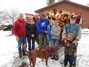 Mike and Jana Frei of Grangeville receive their cord of firewood from Hope Center delivered by the Burt Wolfrum family and Gary Zabel.