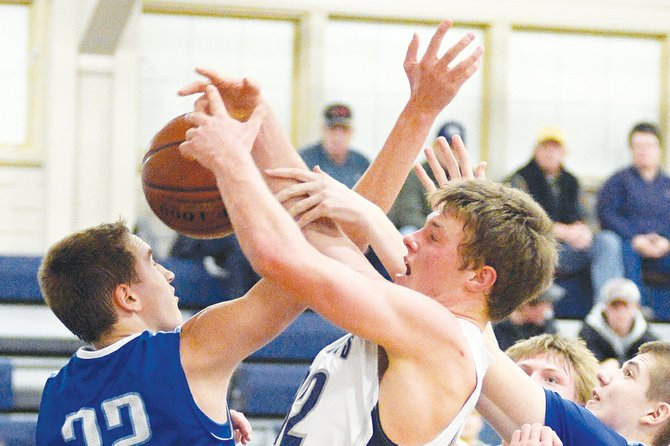 "Bulldogs senior Alex Koberstein battles Colton's Dalton Patchen (blue 32) for an offensive rebound during the second half of Grangeville's Monday night, Jan. 20, victory over the Wildcats. Koberstein finished with four points that night, and totaled six boards against league foe St. Maries earlier in the week. ""We're giving up size, but we're doing a pretty good job in the post,"" coach Skip Hall said."
