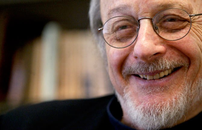 "Author E.L. Doctorow smiles during an interview in his office at New York University. Doctorow's latest book, ""Andrew's Brain,"" takes on the ongoing debates about science vs. literature and humans vs. machines."