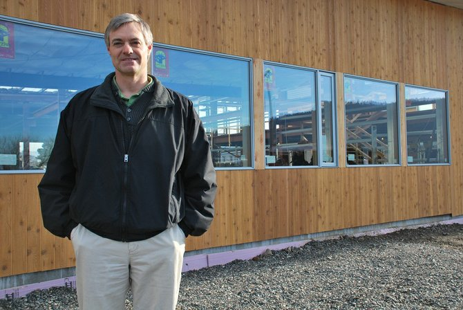 Andy Mack, co-owner of Zepher Inc. in Bingen, stands in front of the 24,000-square-foot building at the Port of Klickitat his company will move into later this year. Zepher started in 2002 with just Mack and his wife, Jaime, a professional engineer, and has since grown to 18 employees that serve manufacturing needs of companies throughout the Gorge and is looking to expand its business reach elsewhere.