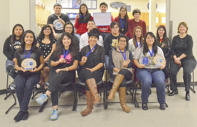 Advisor Erin Ferguson (far right) is pleased with the performance of her DECA students at the Area 10 competition held in Yakima recently. The students include (front L-R) Yesenia Garcia, Rebecca Meza, Briseida Soberanes, Shania Valencia and Karla Villanueva; (middle L-R) Yesmin Salgado, Cassandra Palapos, Celeste Garcia, Shawn Christensen, Vanessa Nieto, Nancy Vega and Dalilah Cuellar; (back L-R) Brian Acosta, Karina Perez, Manuel Calvillo, Esther Estrada and Oscar Sanchez.