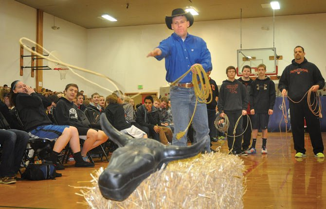 "MAUPIN RANCHER Keith Nantz demonstrates roping techniques during a Wednesday visit to the Yamhill Carlton Intermediate School, which is located about 11 miles east of Newberg. Nantz participated in the ""Know Your Farmer, Know Your Food"" event that was organized by Jane Gullett, food services coordinator for Yamhill, in partnership with the Oregon Cattlemen's Association and several other agricultural organizations.  Nantz will host a visit from students this spring as part of the educational outreach that focuses on the agriculture industry and challenges it faces. He is being featured in a special series on ranching that begins Jan. 26 with an introduction to the cowboy code and way of life."