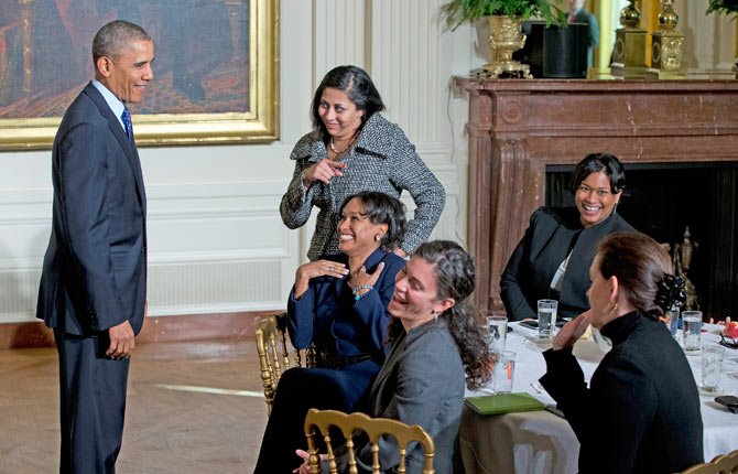President Barack Obama laughs with women in the East Room of the White House in Washington Jan. 22, as he leaves an event for the Council on Women and Girls, where he signed a memorandum creating a task force to respond to campus rapes.