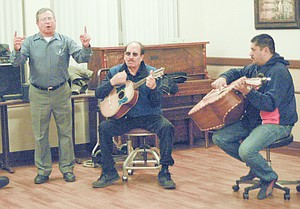From left, David Loyola sings along as David Lepez plays the biguela and Bernaldino Chavez-Licea strums the guitarron at a musical session at Prestige Care & Rehabilitation in Sunnyside this past Monday night.