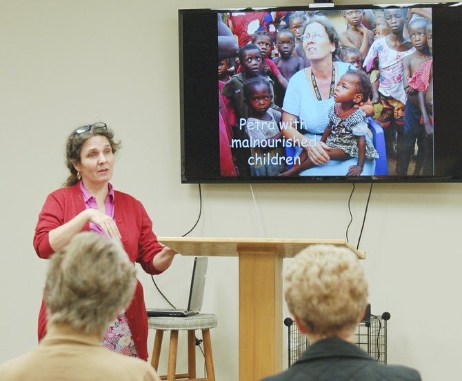 Petra Wirrell, a missionary supported by Sunnyside's Christian Reformed Church, earlier this week talks about her experiences in Sierra Leone at a Wednesday morning meeting at the church. Wirrell will soon be traveling to Gambia to continue serving those in need.