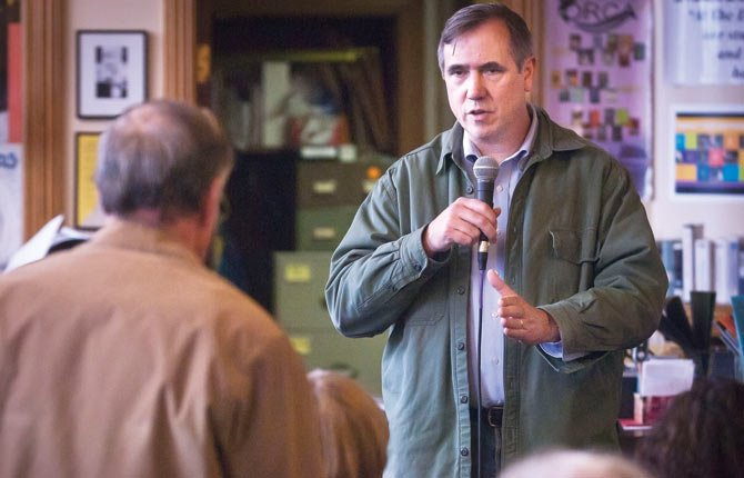 Oregon senator Jeff Merkley (D) answers a question from a Murdock resident regarding coal trains and the federal government's role in regulating them, during a town hall meeting at The Dalles Wahtonka library Thursday morning.