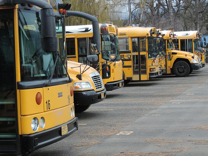 Buses serving Hood River County School District rest at the transportation facility in Odell.
