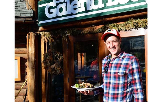 Server Gus Gibbs Carries Food To Waiting Customers At Galena Lodge Near Sun  Valley, Idaho