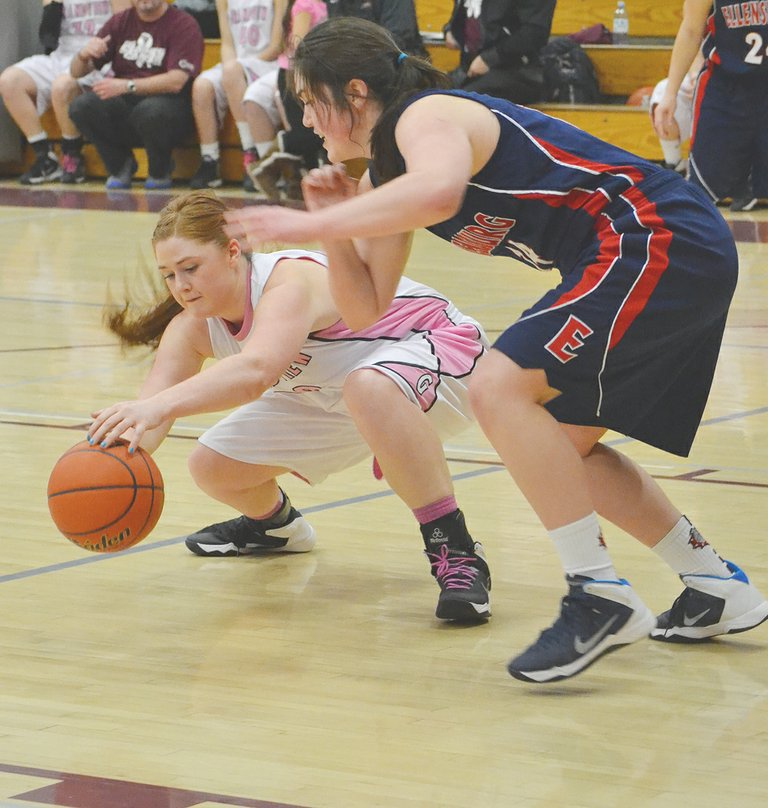 """Grandview's Taylor Hall (L) reaches out for a loose ball under the Lady Greyhound net as Ellensburg's Gese Gruber gives chase. Grandview lost Friday to the Bulldogs by a score of 76-34. Marissa Caballero and Breanna Lopez led Grandview with 13 and 11 points, respectively. The Lady Greyhounds rebounded the following night for a 53-34 win at Othello, with Caballero again leading the way with 14 points, six assists and five steals. Lopez and Samantha Grove each tallied 12 points for the Lady Greyhounds. Grove also hauled down a team-high eight rebounds against the Huskies and recorded three steals. Lopez also had five steals. """"Our defensive effort was better, which turned into some easy scoring opportunities,"""" said Grandview Coach David Gibb. Grandview will host Selah this coming Friday."""
