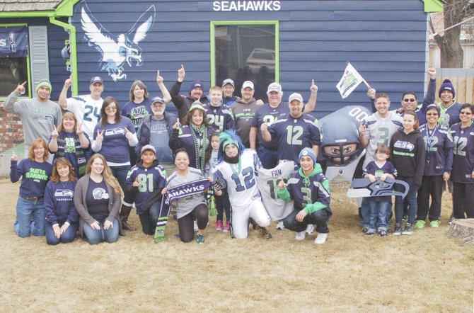 "Sunnyside's most enthusiastic Seattle Seahawks fans, Brad and Wendy Denson of South 15th Street, invited family and friends over for a 12th Man party this past Saturday. The couple, who have painted their home in Seahawk colors, treated their fellow Seahawk fans to an afternoon viewing of the highlights of Seahawk games in preparation for this coming Sunday's main event – the 48th annual Super Bowl. Saturday was also Brad Denson's birthday, who said ""...this is the way to celebrate a birthday."""