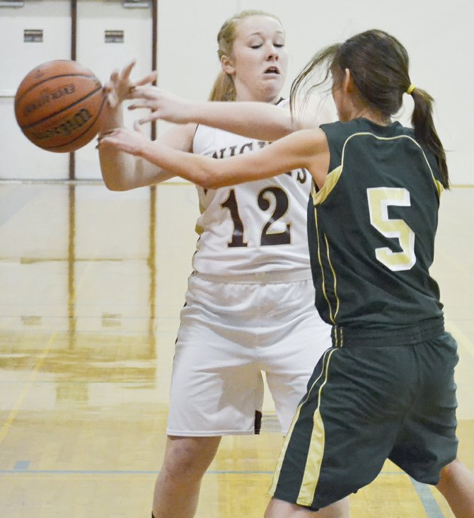 Sunnyside Christian's Melissa Dalrymple (12) has the ball knocked away by DeSales' Teresa Acock in last night's non-league game between the two state-ranked teams. Acock chucked in a team-high 11 points for the Irish. DeSales will get the opportunity to avenge Monday's 51-33 defeat to the Lady Knights, as the same two clubs play again in Walla Walla on Tuesday, Feb. 4.
