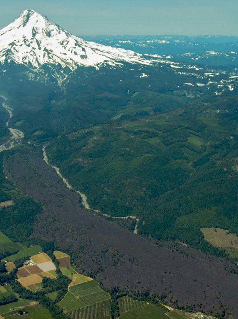 THE LAVA RESTORATION timber thin pro-ject boundary begins just right of the Park-dale lava flow and the Middle Fork of the Hood River seen in this 2008 photo.