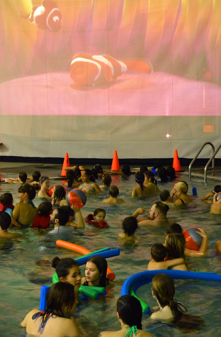 "SWIMMERS enjoy the first-ever ""Dive-In"" movie at the Hood River Aquatic Center last Saturday."
