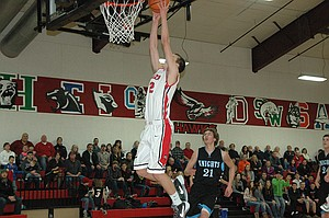 DUNK TIME: Horizon Hawk Mason Bloomster is on his way to a first-half slam dunk he had Friday against Condon/Wheeler.