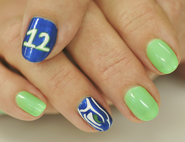Just in time for Super Bowl celebrations this coming Sunday, Kim Taylor-Morris of Sunnyside shows her Seahawk colors with a manicure featuring not only the familiar blue and green of Seattle's Super Bowl team, but even the iconic Seahawk logo and the 12th man symbol. The big game is scheduled to kick-off at 3:30 p.m. this coming Sunday at Metlife Stadium in New Jersey.