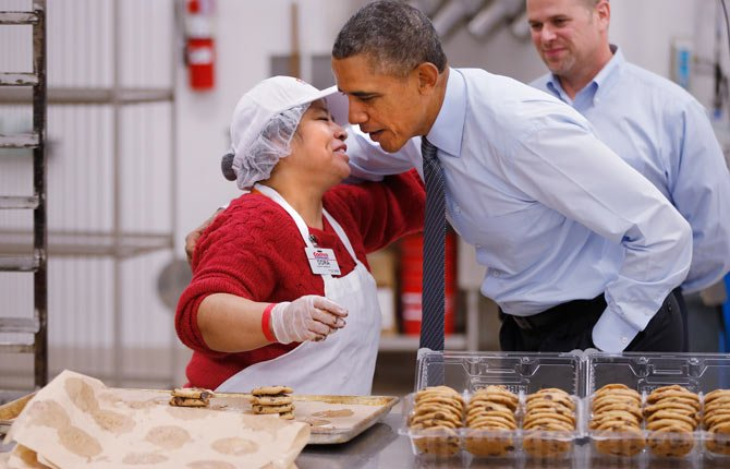 President Barack Obama greets an employee in the bakery at a Costco store in Lanham, Md., Jan. 29, where he spoke about raising the minimum wage the morning after his State of the Union address.