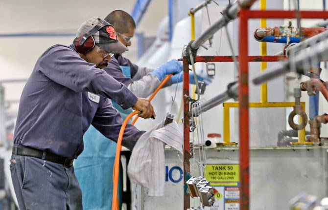 Employees at Sheffield Platers Inc. work on the factory floor in San Diego. The Commerce Department releases fourth-quarter gross domestic product on Thursday, Jan. 30,
