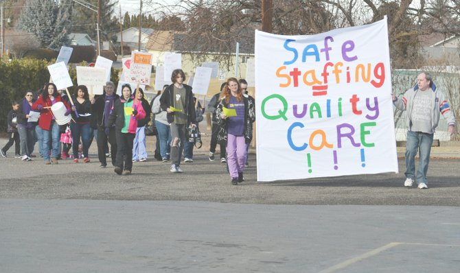 Approximately 20 workers picketed at the Prestige Healthcare facility in Grandview yesterday to protest what they claim are low salaries and unsafe staffing levels.