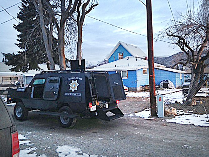 "A Douglas County Sheriff's Office drug task force arrested four people in Bridgeport's ""blue house"" at 1228 Fairview Ave. during an early morning raid today."