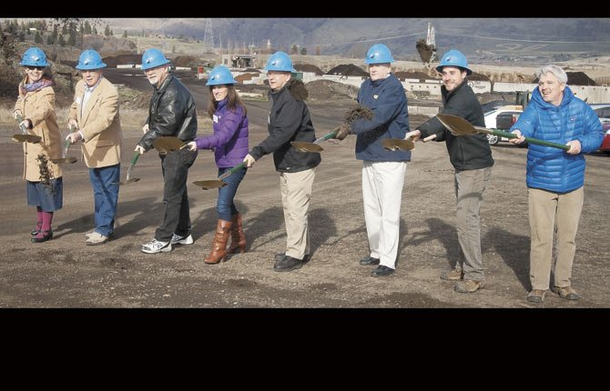 THE PORT OF THE DALLES celebrated groundbreaking on its future North Chenoweth industrial subdivision with festivities Jan. 31. Pictured throwing dirt with golden shovels are, left to right, Andrea Klaas, Port of The Dalles executive director;  Bob McFadden, board president;  Greg Weast, board vice president;  Kristi McCavic, board treasurer;  Mike Courtney, board member;  David Griffith board secretary; Michael Held, Port of The Dalles development specialist and Erik Herr, of Crestline Construction.