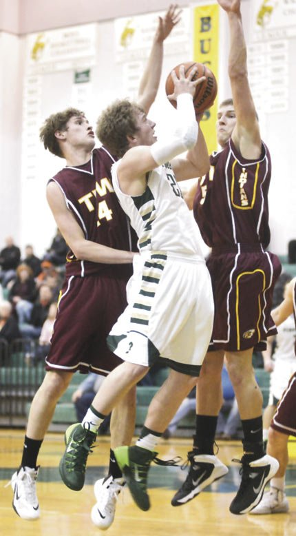 THE DALLES WAHTONKA'S  Austin Wilson (left) and Zach Nerdin converge on Pendleton's Logan Anderson during Friday's hoops contest at Pendleton High School. The Bucks won, 56-45.