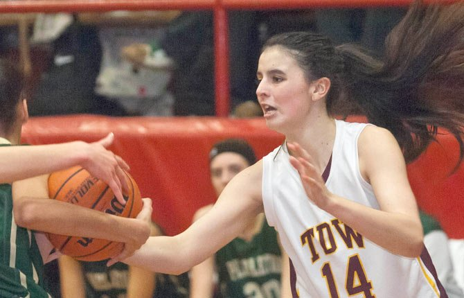 The Dalles Wahtonka sophomore Lori Cimmiyotti, right, tries to slap the ball away from Pendleton senior Charmayne Robinson during Friday's game in The Dalles.