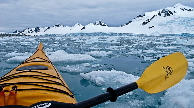 Kayaking around Half Moon Island, surrounded by ice chunks up to five feet large.