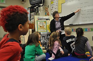 Grangeville Elementary Middle School teacher Chris FitzMaurice instructs her joint kindergarten-first grade class in how a survey is conducted.