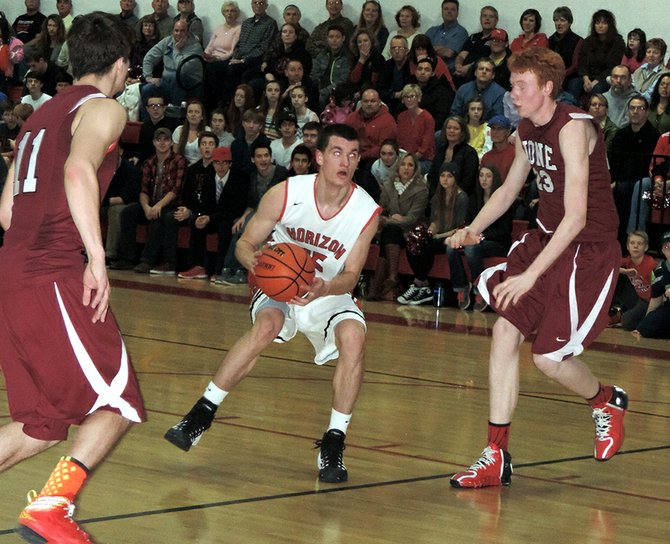 Matt Totaro drives to the hoop Friday night in the Hawks' latest blowout win. The game was booked as the Hawks' tougest challenge in their league schedule, but they won by 31 points.